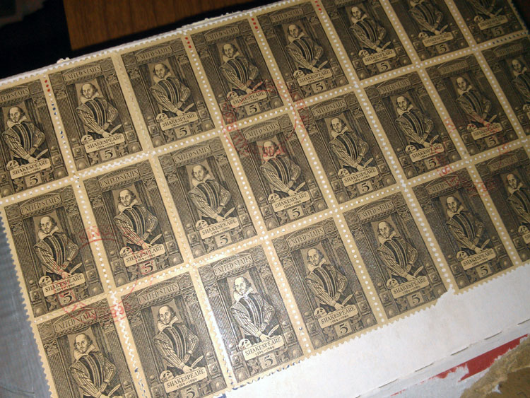 Seller covered the shipping box in vintage sheets of low-denomination stamps, and still had to buy an additional 8 cents of postage on a label.