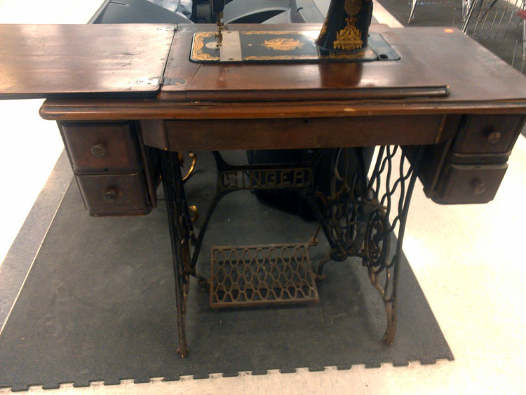 A treadle-table Singer...