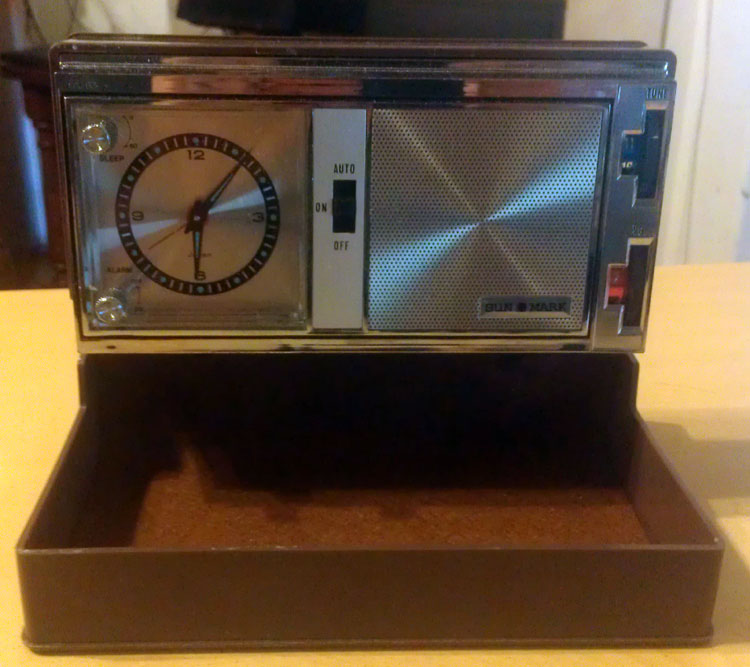 a small travel clock-radio from the 1960's. Made in Japan by Sun-Mark.