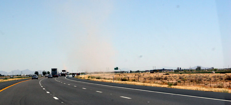 Dust Devil prepares to assult freeway traffic ahead of us. These guys were out in force in the summer heat.