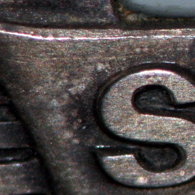 Inside, with a desk lamp, Swissa logo.
