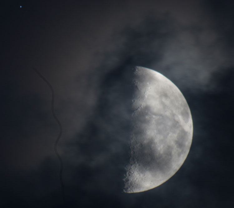 Another try at shooting the moon as it peeked out from behind the clouds. Aaand there's a cat hair in my camera somewhere.. ):