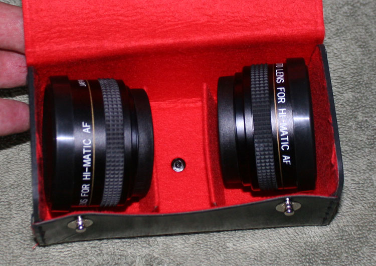An odd set of filter-threaded lenses for a 1979-ish Minolta Hi-Matic AF. Wide-Angle and Telephoto, but meant for a camera with a tiny lens in the center, so they will probably have bad edge vignetting and should result in some very interesting photos. I had to try them out for $5. A step-down adapter to fit them on my main lenses is $7 at Adorama.