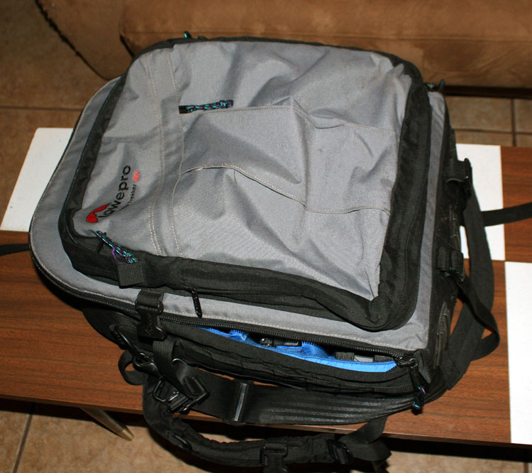 "What's this, a backpack? Wait a minute, I've seen the ""LowePro"" brand on camera bags before.. I wonder..."