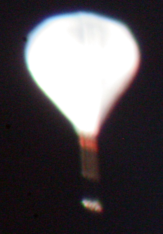 Hmmn, exposure too long and F-stop too wide, and the thing actually is moving awfully fast, but it's a weather balloon.