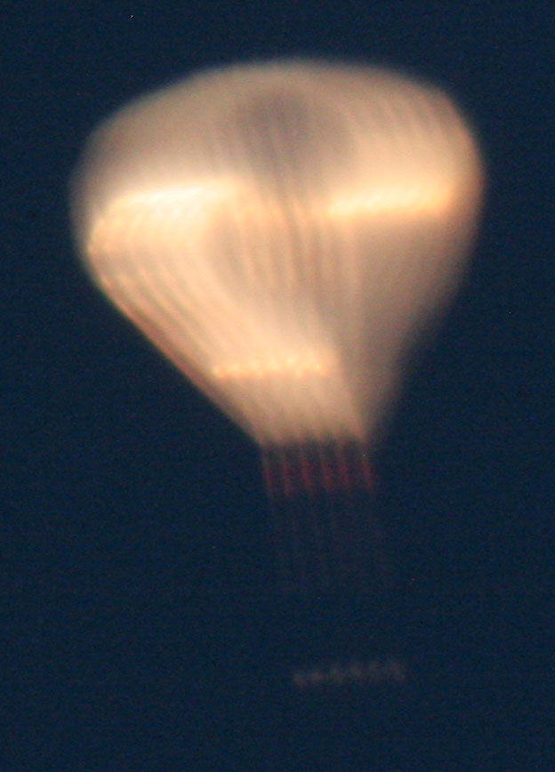 exposure still too long to get the fast-moving balloon to freeze in the frame, but you can see a little more detail now. By the time I got my exposure time set right, the sun had gone behind the horizon and the balloon had vanished. I'll be looking for the UFO sighting reports in the paper tomorrow. :D