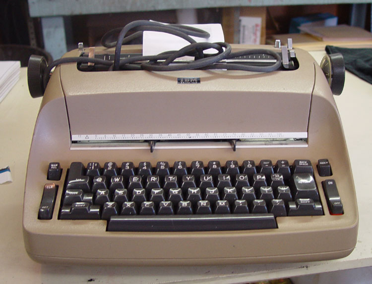 "1971 IBM Selectric 721. After my initial administrations, there's still some sticky keys in the ""QWERTY"" row, and the ""T"" key is intermittent."