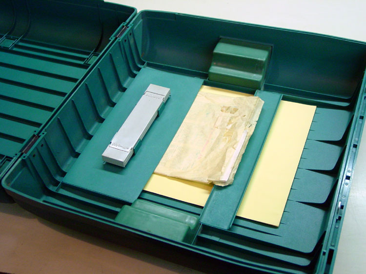 The case is modularly designed and provides storage for spare paper, owner's manual and brushes.
