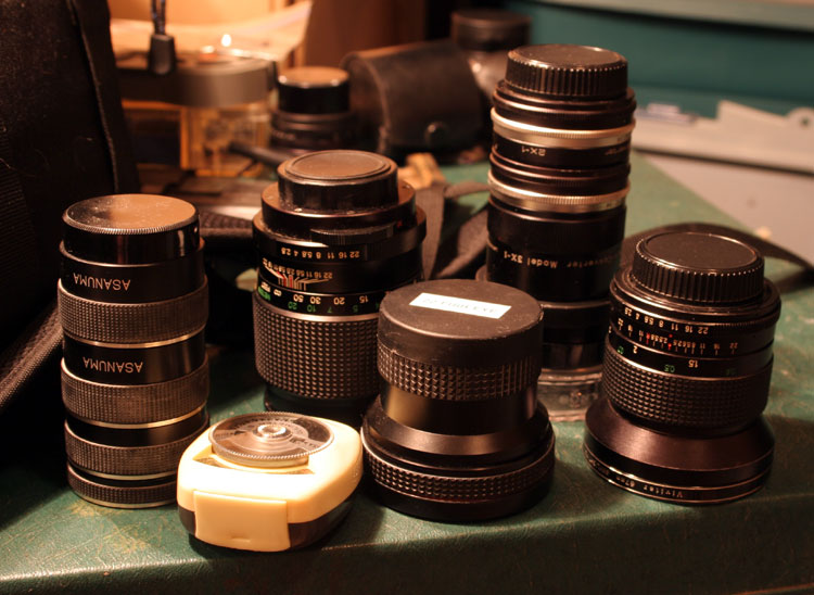 The selection of M42 mount stuff that fits in the bag: 135mm prime, 28mm Wide-Angle prime, .22x Fisheye, 2x and 3X Teledaptor, 4 sizes macro tubes, Agfa Lucimeter S, 4x & 10x magnification lenses. On the Mamiya-Sekor: 85-205mm Close-Focusing Zoom.