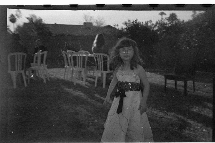 This is why you distribute disposable cameras to the attendees of a wedding. Sometimes you get some really good snaps.