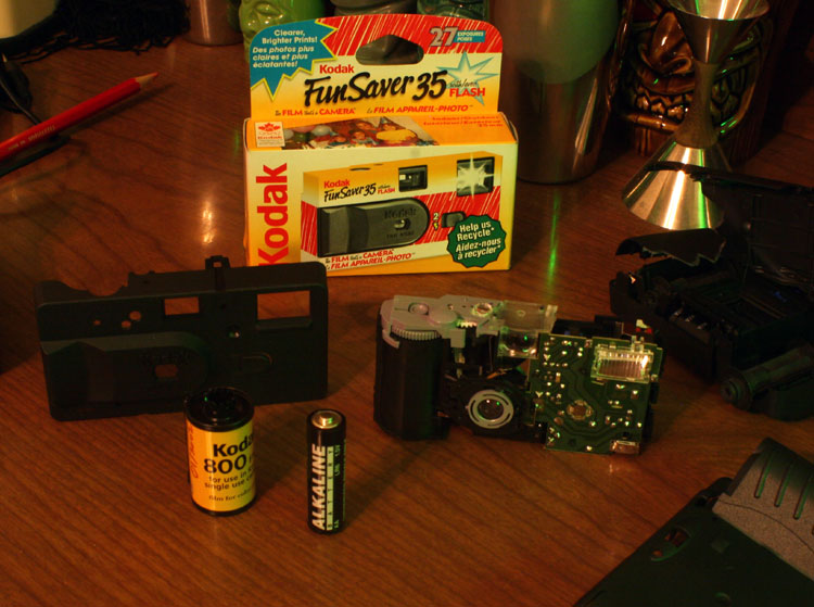 In case you've ever wondered what's inside a Kodak FunSaver 35. Watch out when you disassemble these: you can take out the battery and discharge the flash repeatedly, and *still* the thing will give you a nasty zap if you touch it in the wrong place while it's apart. owch!