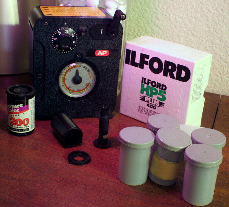 Craigslist is a pretty cheap place to find film. 100 feet of still-sealed Ilford HP5 Plus 400 ISO B&W film, plus 6 reloadable film canisters (5 still loaded with unexposed mystery film) plus one roll of possibly-exposed C-41 for me to try more mystery double-exposures on, plus an AP daylight film loader. I seem to be fully vested in this film photography thing.. :D