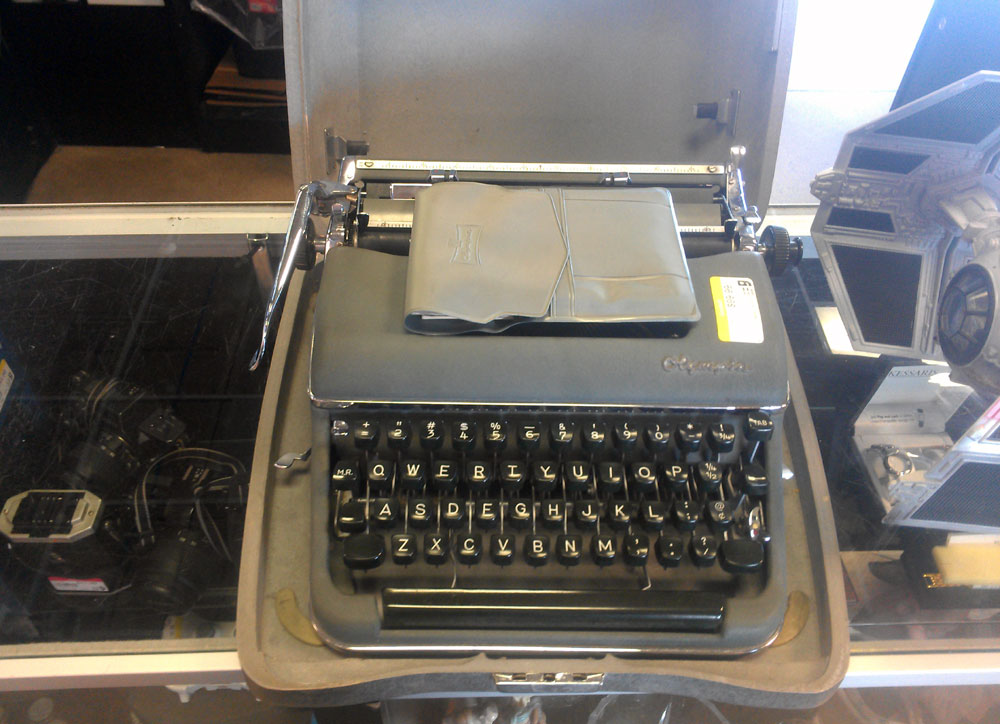Ayup, an Olympia SM3 in really nice condition, complete will tool packet and paperwork. This time it's the Typewriter that's overpriced at $99.99