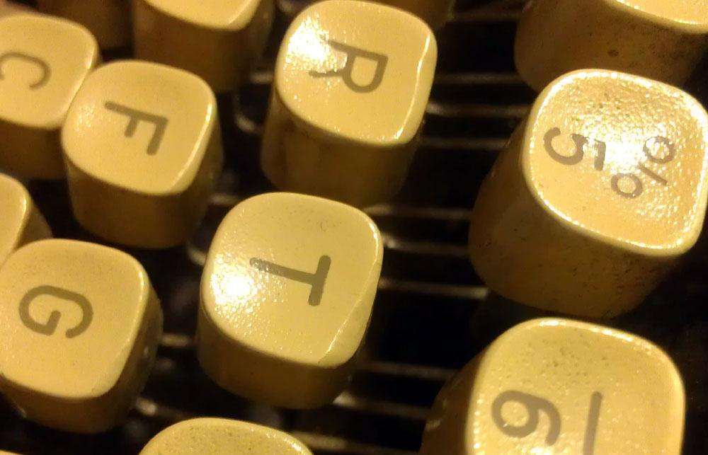 Tops of the keys worn. Long-fingernailed typist?